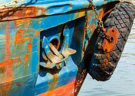 onboard: the lifted anchor onboard the old rusty vessel Stock Photo