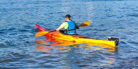 oars: Kayaker on the water in the Pacific Ocean row oars Stock Photo