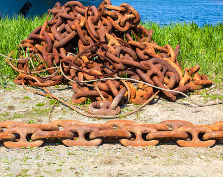 rusty chain: old anchor chain on the seashore