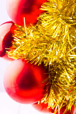 glitzy: blurred background red Christmas balls and shiny ornaments on the white Stock Photo