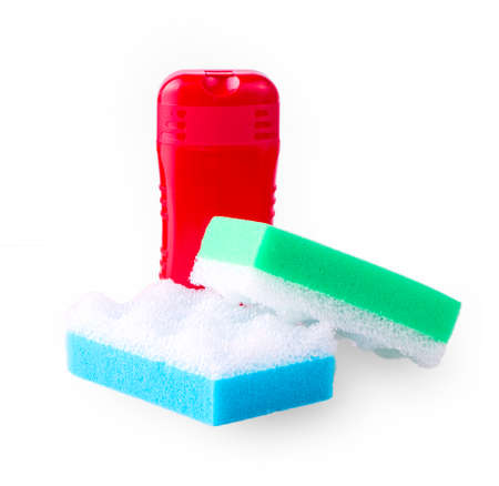 Red shampoo and two colored sponges for body