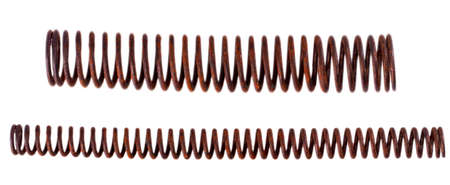 metal old rusty long mechanical springs on white background