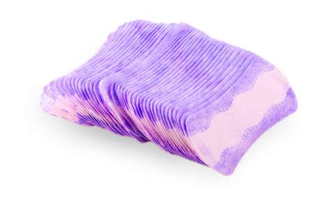 Stack of sanitary feminine napkins on white background