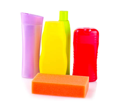 grooming product: bottles of shampoo and balm for hair and sponge on a white background