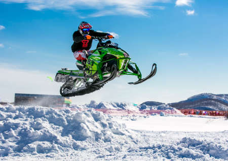 snowmobile rider jumping through snow Stok Fotoğraf - 79688051