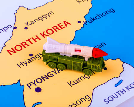 Map of North Korea with a military machine with an intercontinental missile
