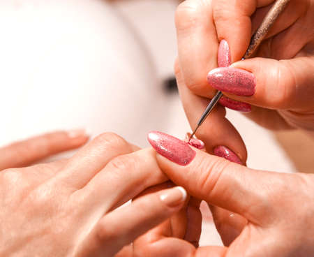 deposition: Master of manicure paints nails Stock Photo