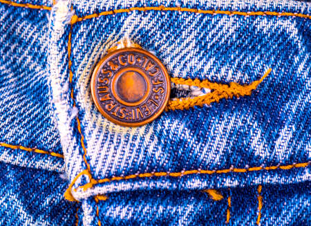 Russia, Kamchatka - JULY 17- 2017: Close up original vintage Levi Strauss metal button of 1937 Levis 503BXX . LEVIS is a brand name of Levi Strauss and Co, founded in 1853.