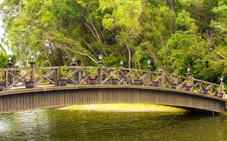 Beautiful wooden bridge across river 免版税图像