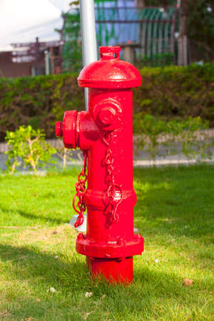 old red fire hydrant with street background