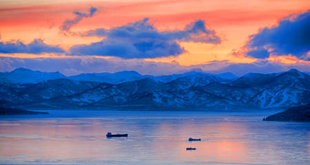 Sunset over vespers Petropavlovsk-Kamchatsky on the background of the Avachinsky bay - Kamchatka, Russia Stock Photo