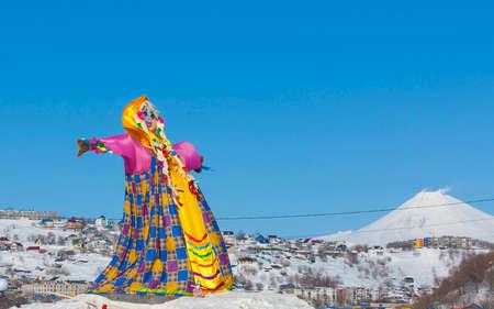 Off winter. Shrovetide in Kamchatka, Russia. Big doll for burning
