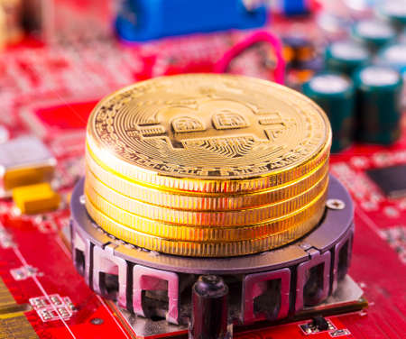 bitcoin concept - gold coin, computer circuit Board with bitcoin processor and microchips. Stock Photo