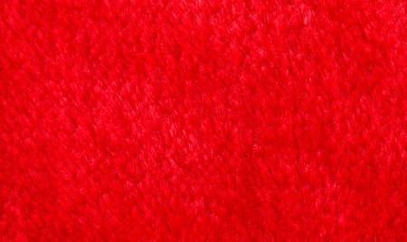 Red bright artificial fur, Faux fur background Stock Photo