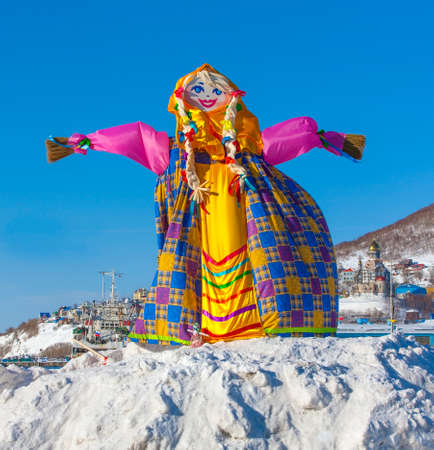 Off winter. Shrovetide in Kamchatka, Russia. Big doll for burning