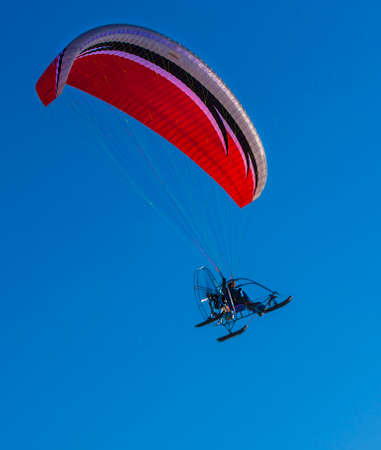 the sport paramotor and blue sky on Kamchatka, Russia