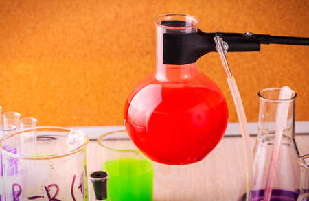 Scientists are stopping the substance in a test tube in a laboratory chemistry