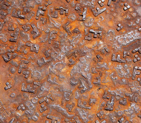 Detail of the rusty pattern from a manhole cover Stock Photo