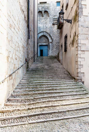 Steep stairs and narrow street in old town of Gerona, Spain Stock Photo