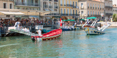 SETE, FRANCE - June 20, 2017: Water jousting competition which lasted in Sete on the south of France. Jousting is a fight on the boat practised principally in France Editorial