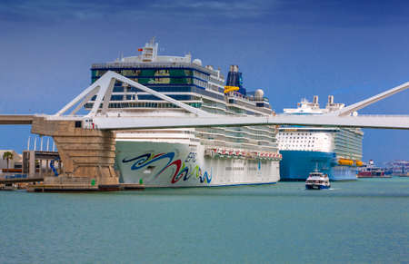 Barcelona, Spain - JUNE 10, 2018: Ocean liners  Norwegian Epicin and Symphony of the Seas in sea port. Cruise destination on liner trip. Travelling by sea liner. Summer vacation holiday. Wanderlust and liner discovery.