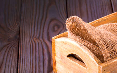 the Wooden box on sack cloth on wooden background