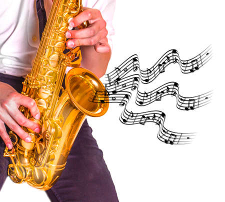 The young men playing saxophone. Close up of men playing saxophone