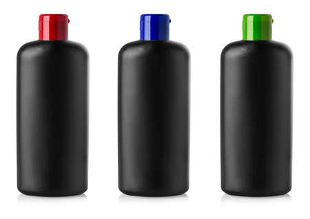 Black  blank plastic bottles with colored can on isolated background Banco de Imagens