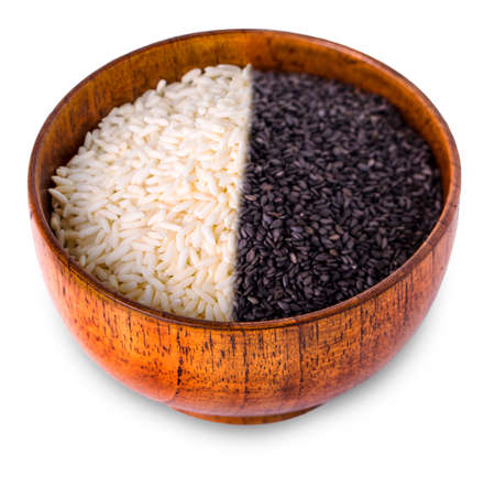White and black rice in wooden bowl on white background. Close up, high resolution product.