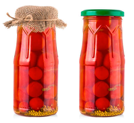 The pickled cherry tomato in glass jar on white background Banco de Imagens
