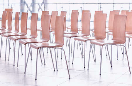 Rows of chairs - meeting background. Imagens