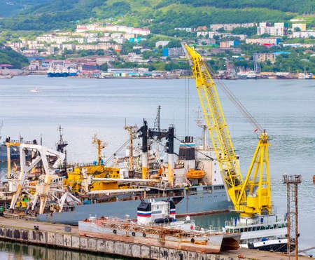 ships at pier, port cranes on commercial seaport Petropavlovsk-Kamchatsky