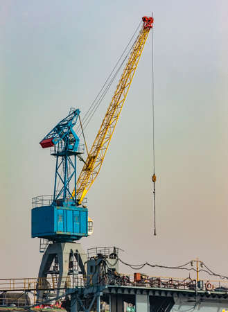 High crane on the construction site in a sunny day