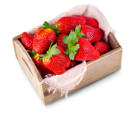 fresh strawberries in a wooden box on a white background