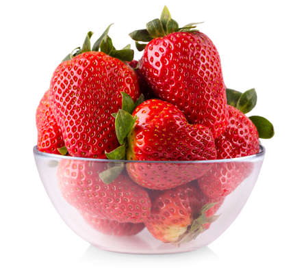 Red fresh strawberry in a glass bowl isolated on white background