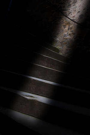 The strip of light on the old dark staircase Imagens