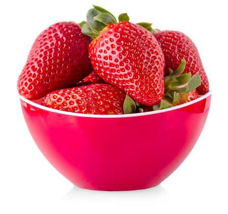 Red fresh strawberry in the red bowl isolated on white background