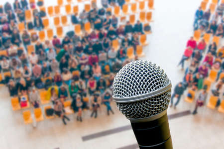 microphone and top view of meeting room blur background, business Meeting Conference, Team learning concept. Stock Photo