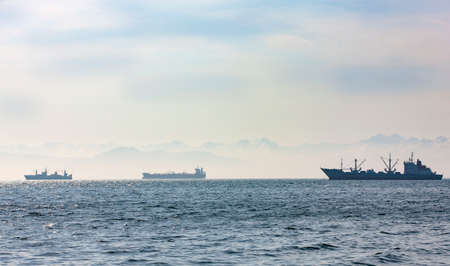 large fishing vessel on the background of hills and volcanoes Reklamní fotografie