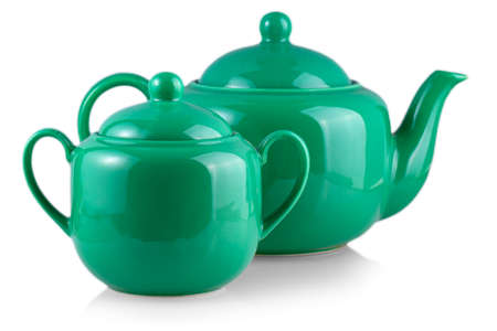green teapot and sugar bowl on white