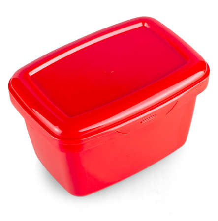 red plastic box with spicy Korean sauce isolated on white
