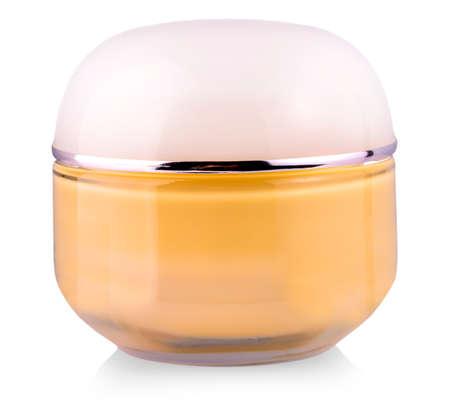 Tonal cream in glass jar on white background closeup Imagens
