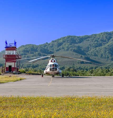 Helicopter on the helipad on Kamchatka Reklamní fotografie