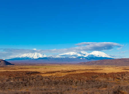 The three snow volcanoes in Kamchatka Peninsula