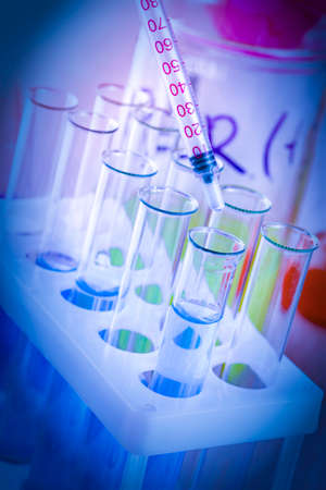 test tubes and flasks with colored liquid in a laboratory