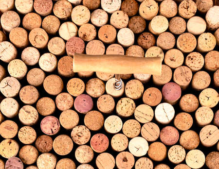 The Corkscrew and wine cork as background