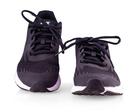 Black sneakers running shoes isolated on white background
