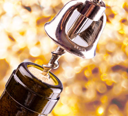 Opening a wine bottle with a cork screw Archivio Fotografico - 127173481