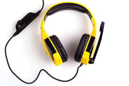 Yellow headphones with a microphone isolated on white background