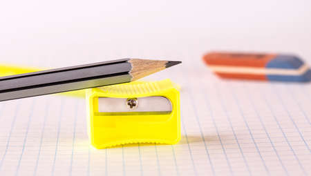 Pencils with pencil sharpener and eraser isolated on white background Imagens